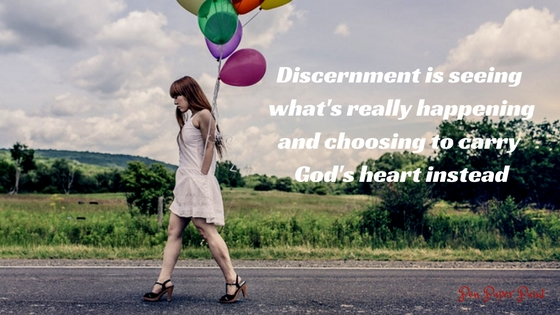 Self-awareness picture of woman carrying balloons walking on road